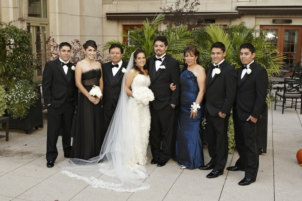 Bride and groom with Edgar's family members