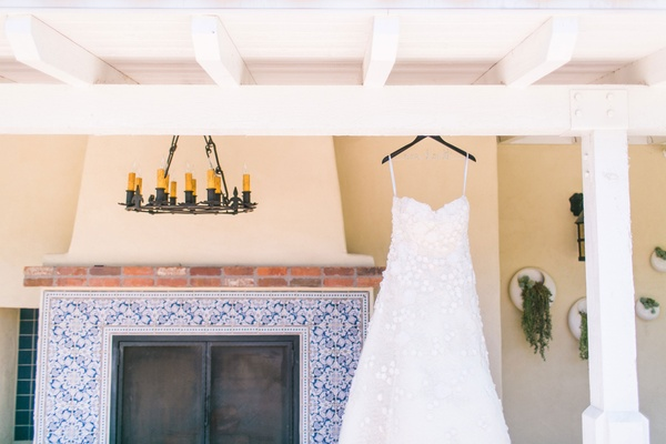 Strapless flower applique Oscar de la Renta dress hanging from beams at The Inn at Rancho Santa Fe
