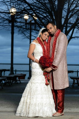 Indian woman wearing bridal gown and man in sherwani