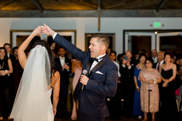 groom sings to bride during their first dance