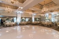 round white dance floor, chandeliers above wedding dance floor