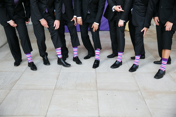 grooms and groomsmen in purple, blue, and pink striped socks