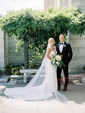 bride in pronovias wedding dress illusion neckline details cathedral veil protea tropical bouquet