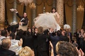 bride in vera wang ball gown, groom in tuxedo, bride and groom lifted during chair in hora