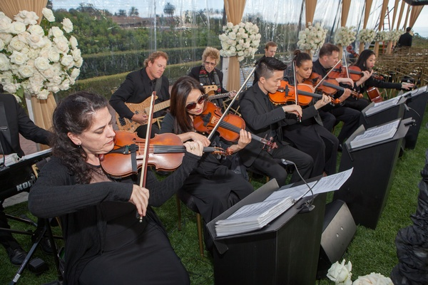 Wedding ceremony clear tent white flowers musicians in black outfits with violin viola string