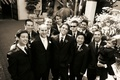 Black and white photo of groomsmen and ring bearer