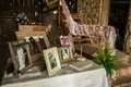 Guest book and family photo table at barn wedding