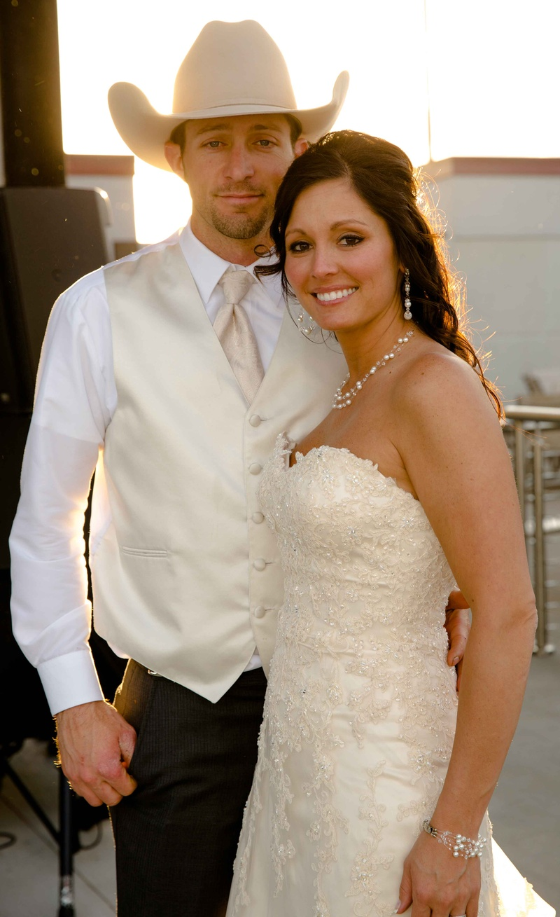 4324bbe836c Shelly Bartels in Maggie Sottero wedding dress and Tyrel Nelson in white  wedding attire