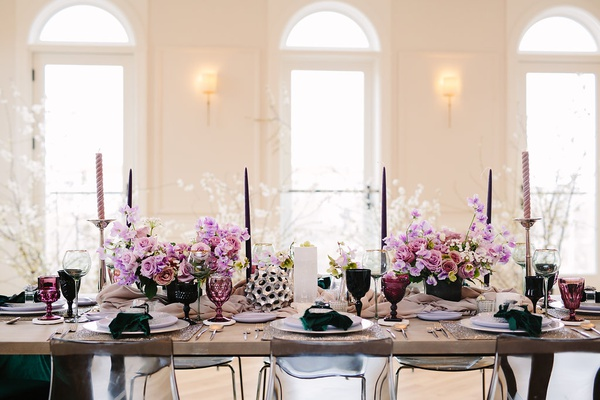 edgy alternative wedding inspiration, lavender stock, tapered candles, colorful goblets