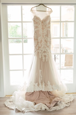 blush wedding dress with lace overlay and cap sleeves