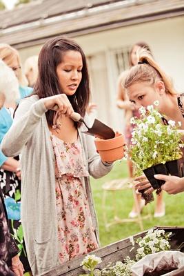 Guests pot plants outside