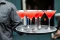 Orange and red wedding signature cocktails in martini glasses