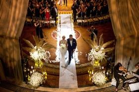 wedding ceremony bird's eye view white aisle runner flower petals gold palm leaves white hydrangea
