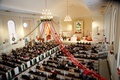 wedding ceremony at church in cleveland ohio red ribbon hanging from chandelier holiday christmas