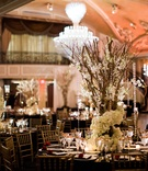 san francisco giants joe panik wedding, centerpieces with branches intertwined with flowers crystals