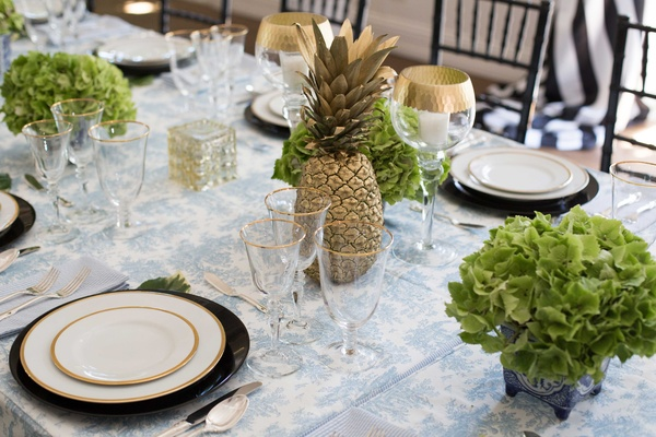 southern-inspired wedding, summer reception décor pineapple gold centerpiece green hydrangea