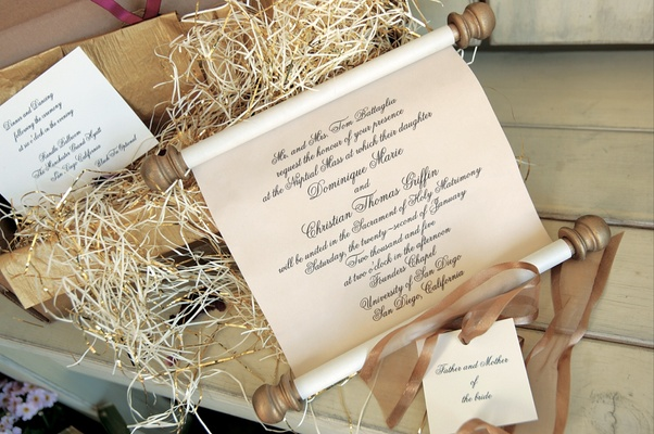 Regal scroll invites in gold box with raffia