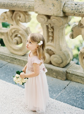 destination wedding in lake como italy at Villa del Balbianello flower girl in pink tulle lace dress