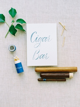 Wedding reception outdoor cigar bar at reception with matches personalized and cigar options