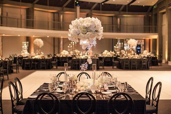 floating centerpiece with orchids, roses, hydrangeas, flowers encased in lucite