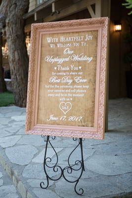 wooden wedding welcome sign in blush frame