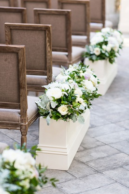 Wedding ceremony wood chairs white flower box with greenery rose peony flowers stone pathway