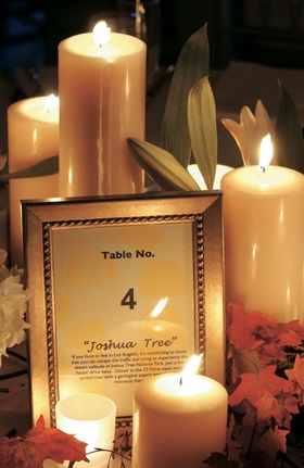 White and yellow table card in silver frame