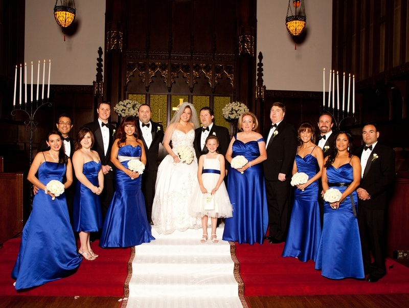 Photograph of couple, bridesmaids, and groomsmen