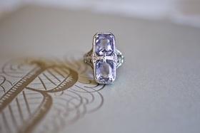 Bride's two-stone, emerald-cut amethyst ring
