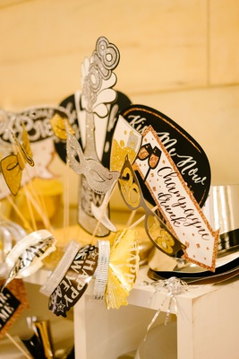 wedding reception new year's eve photo booth props signs tiaras hats champagne