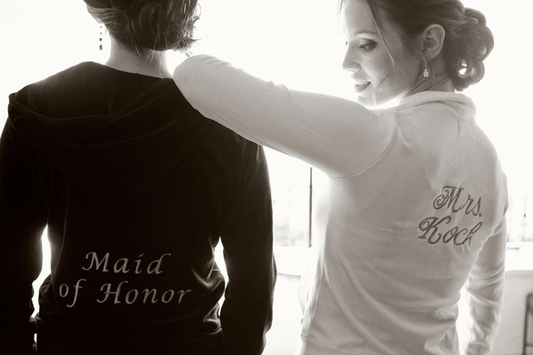 Black and white photo bride and maid of honor in velour outfits