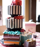 Black and white striped cake with fashion details