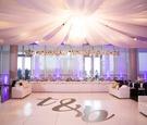 wedding reception brendan haywood dance floor head table white flowers overhead drapery tent