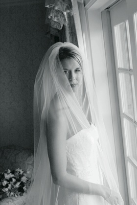 Black and white image of bride in bridal suite
