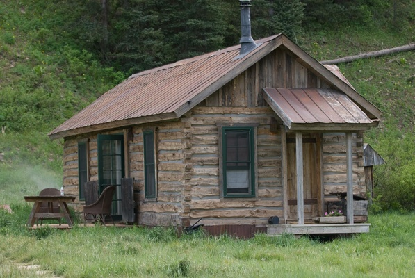 Old wood cabin in grass mountain region