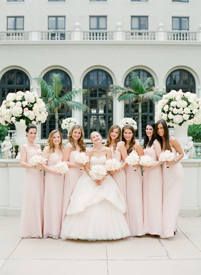 Bride with bridesmaids in floor-length gowns