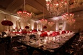 ballroom wedding reception black red white silver color palette chandeliers red shades mirror runner