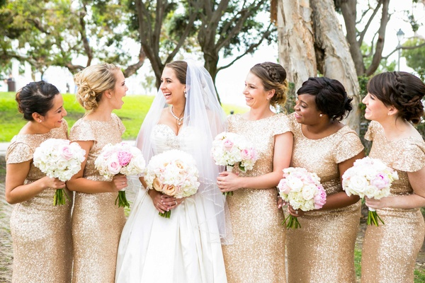 bride in allure ball gown, bridesmaids in gold sequin sorella vita gowns