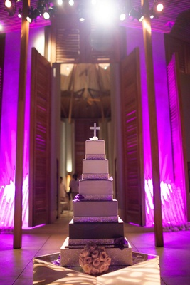 Ombre wedding cake with silver bands and crystal cross topper