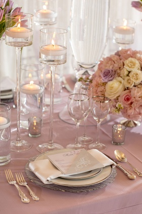 Wedding reception lavender purple linen silver rim glasses floating candles low centerpiece