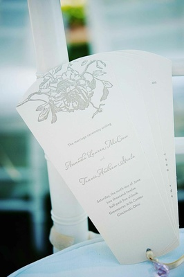 White and grey wedding program in fan shape