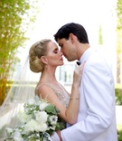 couple close embrace first look Liancarlo gown dress champagne embellishments bouquet white suit