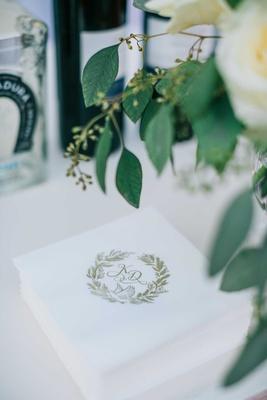 wedding reception cocktail beverage napkin at bar gold monogram dove symbol