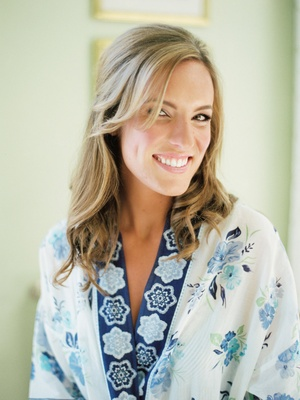 Bride with half up half down wedding hairstyle in blue and white flower print robe