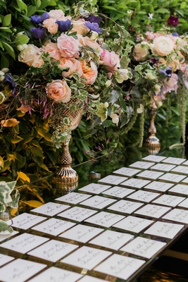 Wedding reception outdoor escort card table mirror with gold vase rose purple flowers pink burgundy