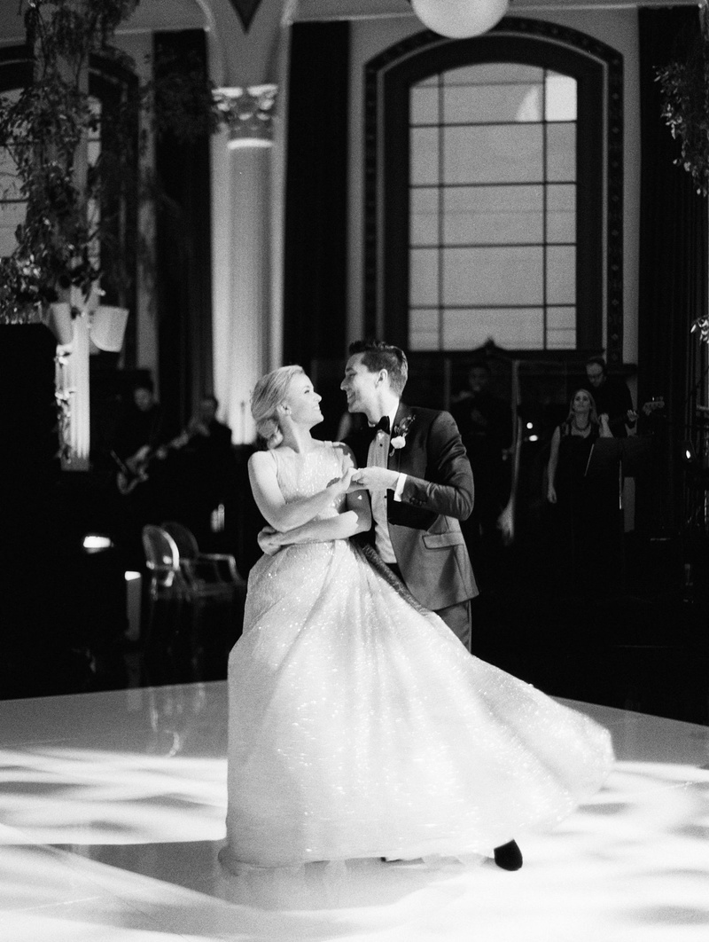 black and white photo of bride and groom first dance twirl ball gown at vibiana wedding venue