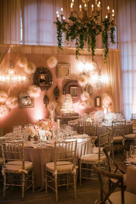 Indoor wedding with garden theme and gallery wall