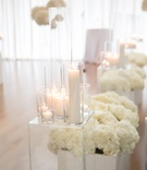 wedding ceremony aisle decorations lucite riser candles white hydrangea flowers