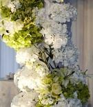 Green and white hydrangea, lily, and rose flowers
