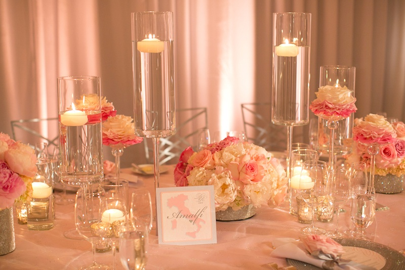 Floating candles and rose and peony flowers at reception